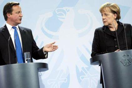 Cancelarul german şi premierul britanic nu cad de acord pentru salvarea Zonei euro