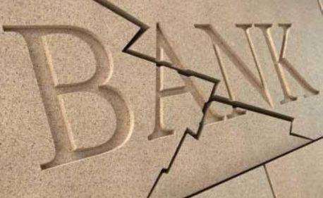 Două mari bănci sunt împinse simultan în incapacitate de plată, de către persistenţa crizei mondiale
